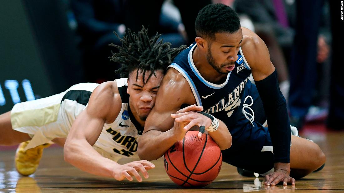 Purdue guard Carsen Edwards, left, and Villanova's Phil Booth dive for a loose ball during their second round game of the 2019 NCAA Men's Basketball Tournament in Hartford, Connecticut on Saturday, March 23. Purdue defeated Villanova to advance to the Sweet 16.