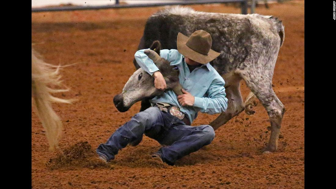 Cayden Harmon of Lipan, Texas, competes in steer wrestling during the American Junior Rodeo Association Youth Rodeo in Midland, Texas on Saturday, March 23.