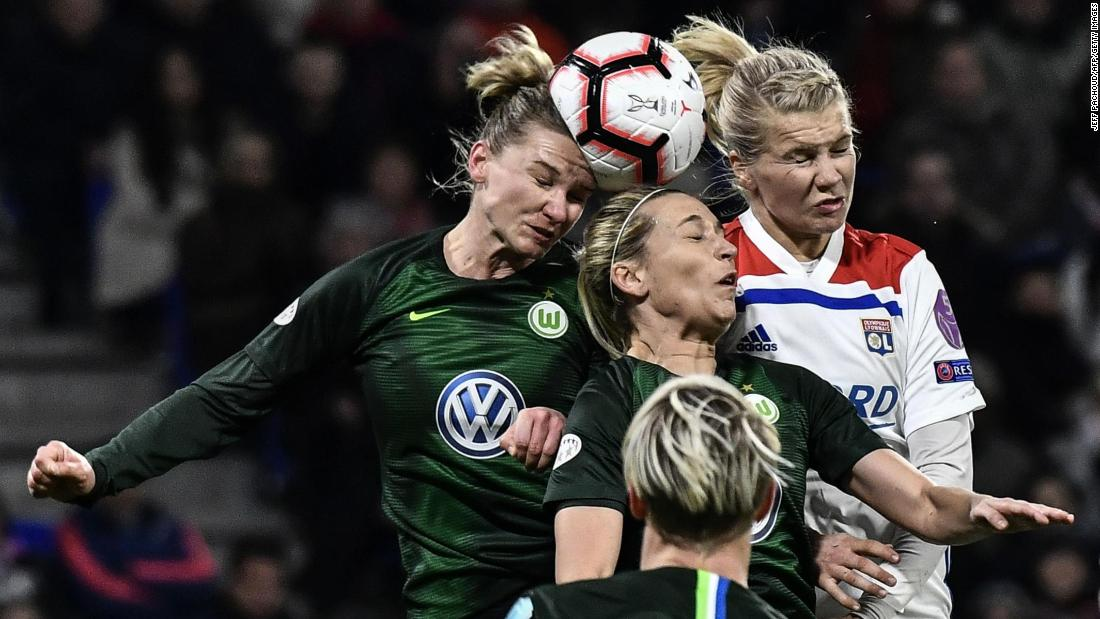 VfL Wolfsburg players Alexandra Popp, left, and Lena Goessling, center, compete for a loose ball with Ada Hegerberg of the Olympique Lyonnais during a UEFA women's Champions League quarter-final soccer match in Decines-Charpieu, France on Wednesday, March 20.