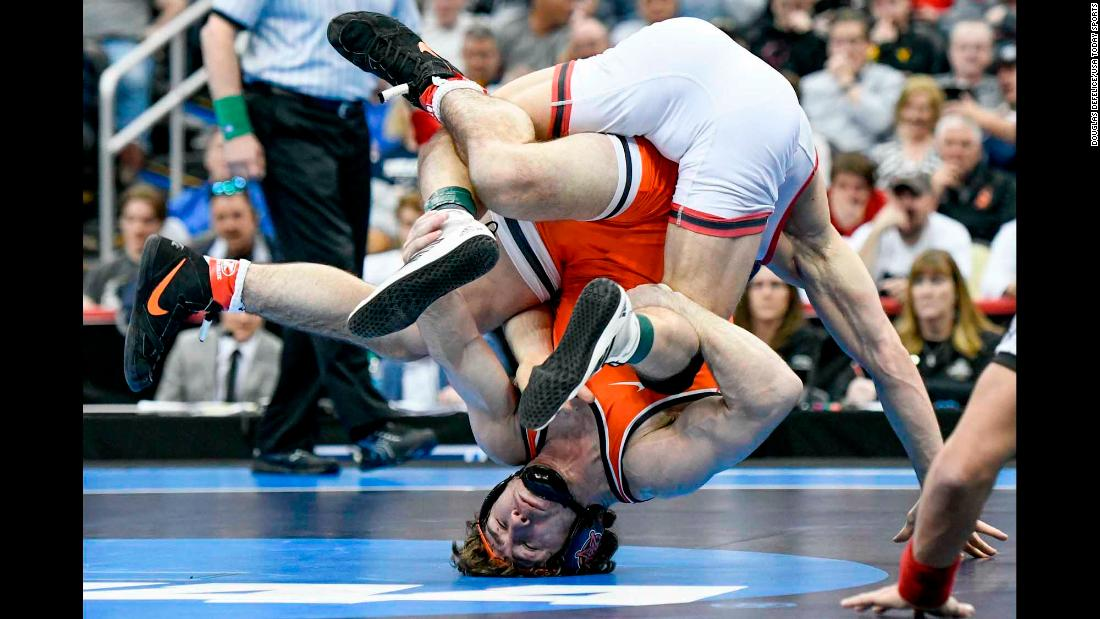 Oklahoma State wrestler Daton Fix (orange) wrestles Nick Suriano of Rutguers (white) in the finals of the 133 pound weight class during the NCAA Wrestling Championships at PPG Paints Arena in Pittsburgh on Saturday, March 23.