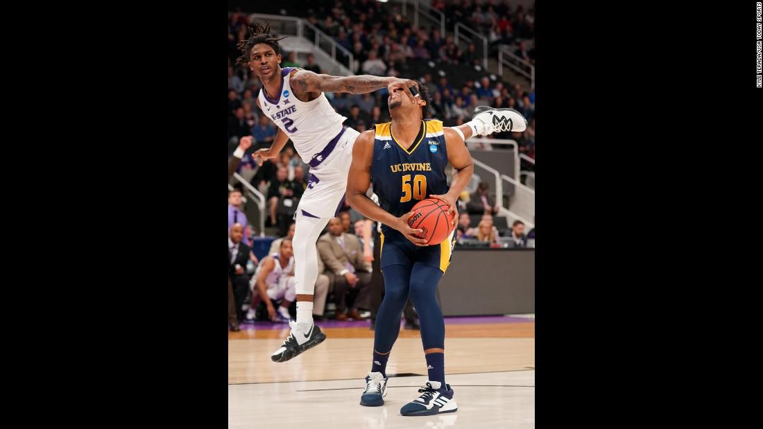 Kansas State Wildcats guard Cartier Diarra grabs the face of UC Irvine forward Elston Jones during their first-round game of the 2019 NCAA Men's Basketball Tournament in San Jose, California on Friday, March 22.