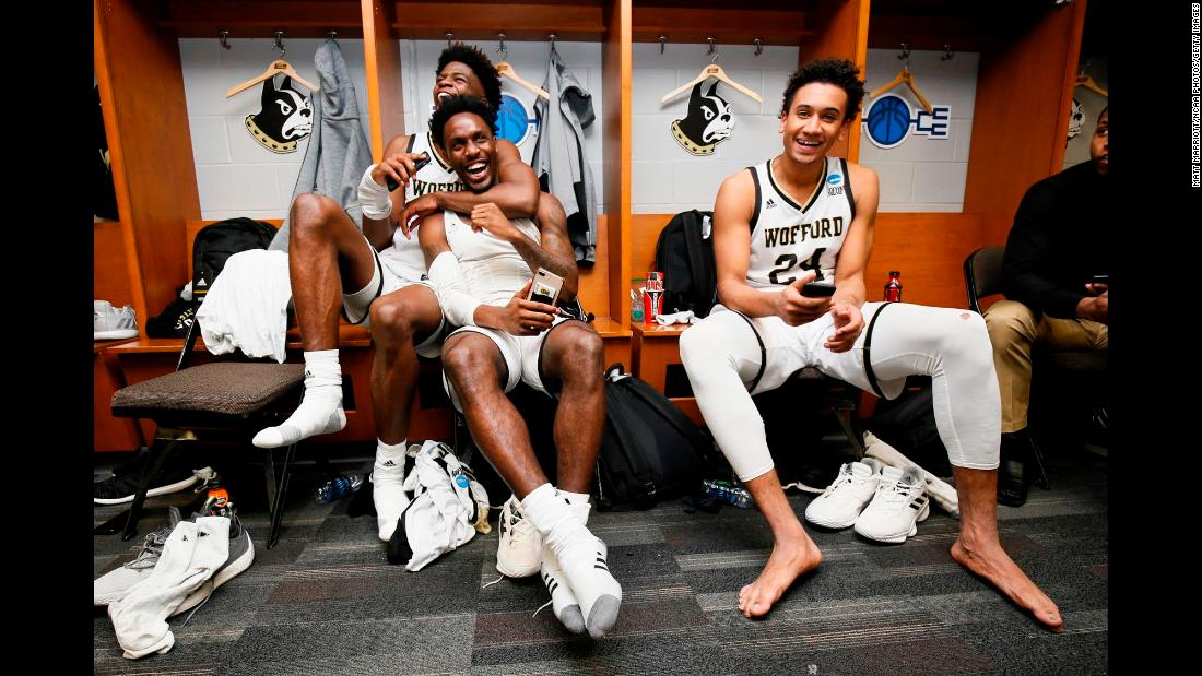 From left, Wofford Terriers teammates Chevez Goodwin, Tray Hollowell and Keve Aluma celebrate in the locker room after defeating the Seton Hall Pirates in the first round of the 2019 NCAA Men's Basketball Tournament in Jacksonville, Florida on Thursday, March 21.