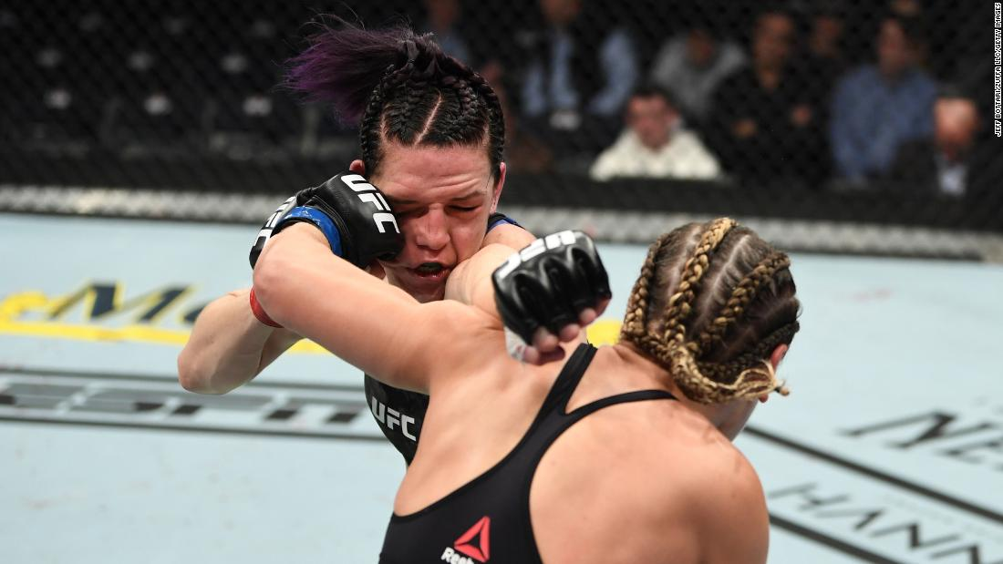 Jennifer Maia, right, and Alexis Davis, left, exchange punches in their women's UFC flyweight bout at Bridgestone Arena in Nashville on Saturday, March 23.