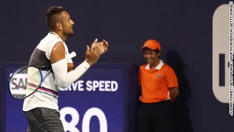 Kyrgios claps as the fan is shown off the court