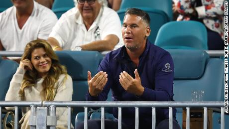 A spectator goads Kyrgios -- while the woman sitting next to him looks somewhat embarrassed
