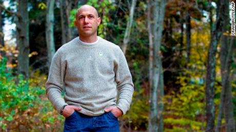 In this photo taken Oct. 30, 2013, Jeremy Richman in Newtown stands the backyard of his home in Newtown, Conn. His daughter, Avielle Richman, was one of 20 Sandy Hook Elementary School students that were killed in a mass shooting Dec. 14, 2012. As the Richman's gathered with friends who offered support, an idea emerged on the day of Avielle's funeral for a way to channel their grief and try to prevent other such tragedies  a foundation to support research into the brain pathologies behind violence. (AP Photo/Craig Ruttle)