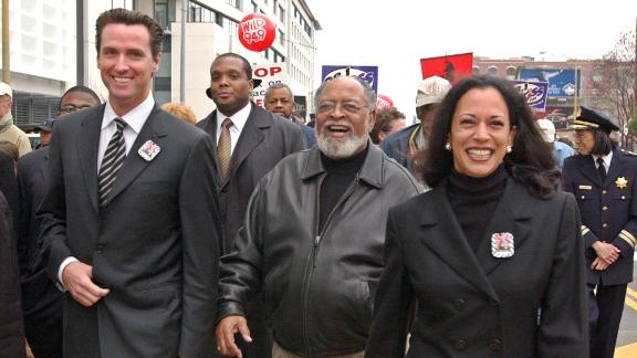Harris is joined by San Francisco Mayor Gavin Newsom, left, and the Rev. Cecil  Williams, center, for a San Francisco march celebrating Martin Luther King Jr. in January 2004. Harris was the city's district attorney from 2004 to 2011.