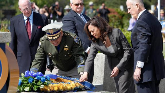 In May 2013, Harris and California Highway Patrol Commissioner Joe Farrow place a wreath honoring Highway Patrol officers who were killed in the line of duty.
