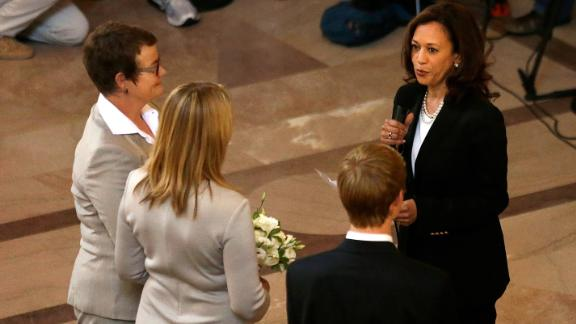 Harris officiates the wedding of Kris Perry, left, and Sandy Stier in June 2013. Perry and Stier were married after a federal appeals court cleared the way for California to immediately resume issuing marriage licenses to same-sex couples.