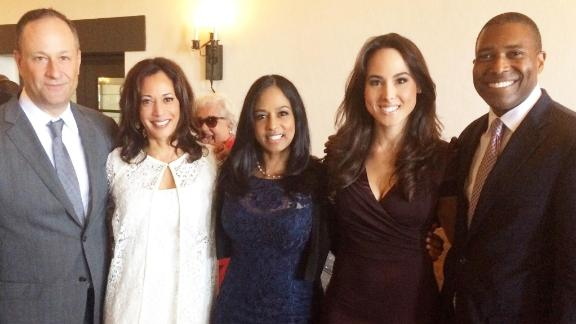 Harris is flanked by her husband, Douglas Emhoff, and her sister, Maya. Next to Maya Harris is Maya's daughter, Meena, and Maya's husband, Tony West.
