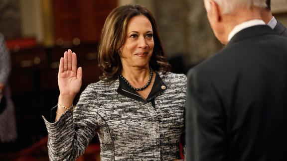 Harris, as a new member of the Senate, participates in a re-enacted swearing-in with Vice President Joe Biden in January 2017. She is the first Indian-American and the second African-American woman to serve as a US senator.