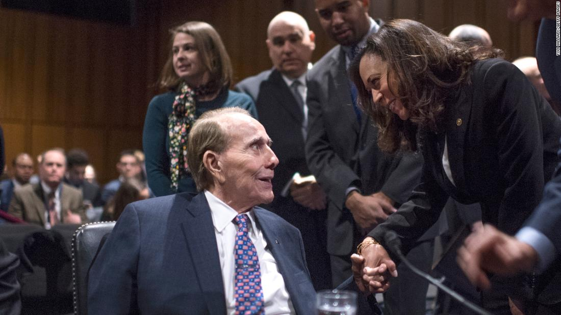 Harris talks with former US Sen. Bob Dole on Capitol Hill in January 2017.