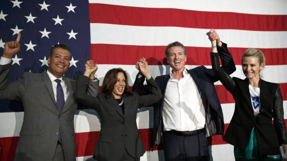 Harris attends a rally with, from left, California Secretary of State Alex Padilla, gubernatorial candidate Gavin Newsom, and Newsom's wife, Jennifer, in May 2018. Newsom won the election in November.