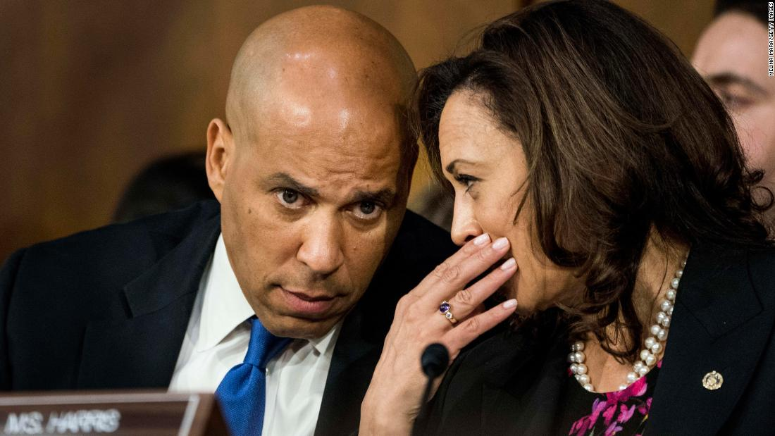 Harris speaks with US Sen. Cory Booker during the confirmation hearing for Supreme Court nominee Brett Kavanaugh in September 2018.