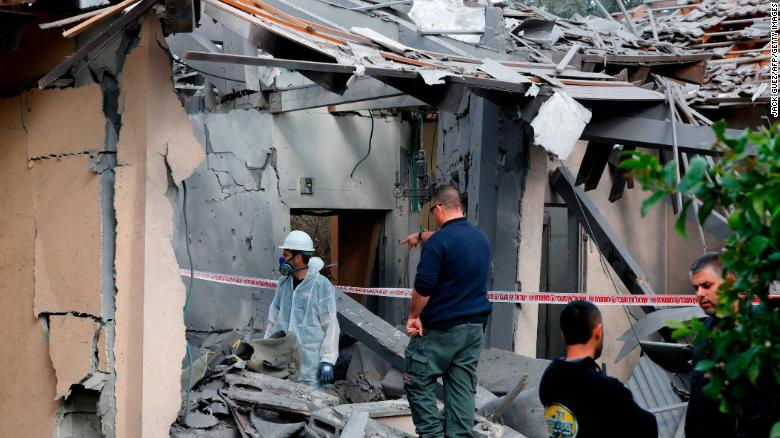 A general view shows emergency responders inspecting a damaged house after it was hit by a rocket in the village of Mishmeret, north of Tel Aviv on March 25, 2019. - A rocket hit a house in a community north of Tel Aviv and caused it to catch fire on Monday, wounding five Israelis, police and medics said. (Photo by Jack GUEZ / AFP) (Photo credit should read JACK GUEZ/AFP/Getty Images)