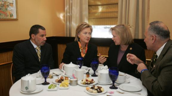 Gillibrand talks with Hillary Clinton during a lunch meeting that included New York Gov. David Paterson, left, and US Sen. Chuck Schumer in January 2009. Paterson appointed Gillibrand to replace Clinton as US senator. Gillibrand later won a special primary election in 2010 and was re-elected in 2012.
