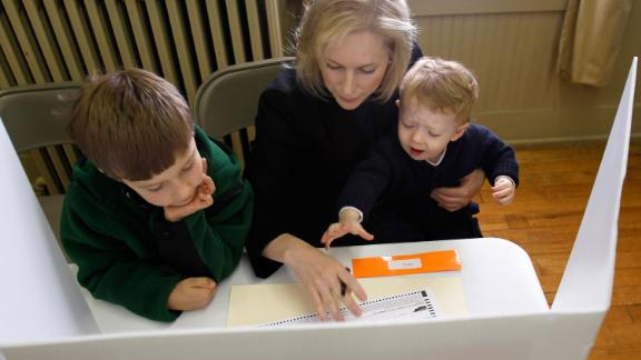 Gillibrand votes with her sons Theo, left, and Henry in November 2010.