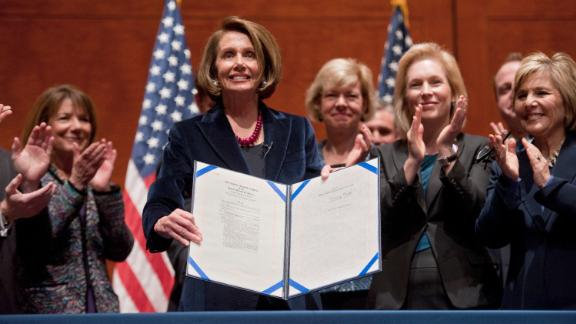 """Gillibrand joins House Speaker Nancy Pelosi during the signing of the bill that repealed the US military's """"don't ask, don't tell"""" policy in December 2010."""