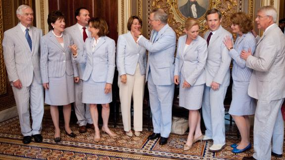 Gillibrand, fourth from right, and other senators wear seersucker suits in Washington in June 2011. The third Thursday of June is traditionally called Seersucker Thursday.