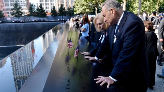 Gillibrand and Schumer place American flags at the reflecting pools of the World Trade Center Memorial in 2012.