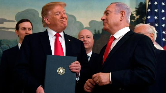 President Donald Trump smiles at Israeli Prime Minister Benjamin Netanyahu, right, after signing a proclamation in the Diplomatic Reception Room at the White House in Washington, Monday, March 25, 2019. Trump signed an official proclamation formally recognizing Israel's sovereignty over the Golan Heights. (AP Photo/Susan Walsh)