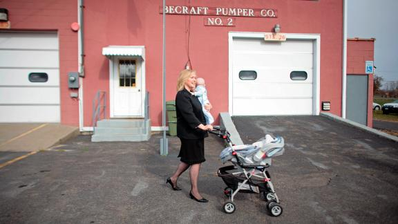 Gillibrand walks with her infant son, Henry, after voting in Greenport, New York, in 2008. She has two sons with her husband, Jonathan.