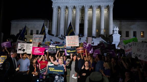 Gillibrand speaks to demonstrators outside the Supreme Court after President Donald Trump announced Brett Kavanaugh as a Supreme Court nominee in July 2018.