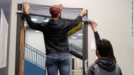 Richland Two Institute students put up a curtain that can be remotely lowered to block a shooter's visibility.