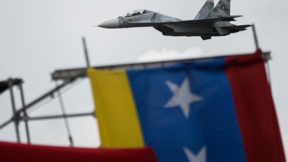 Russian-made Venezuelan Air Force Sukhoi Su-30MKV multirole strike fighters overfly a military parade to celebrate Venezuela