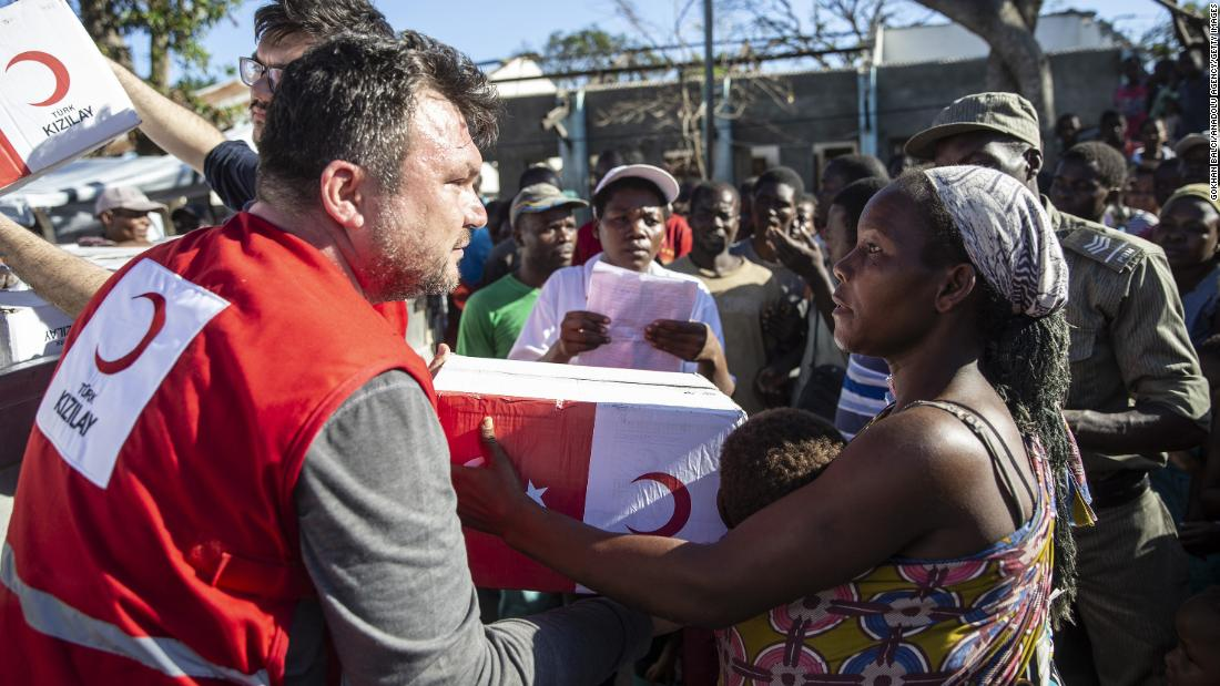 People receive supplies from a Turkish aid agency in Muabvi village of Beira, Mozambique, on Monday, March 25.