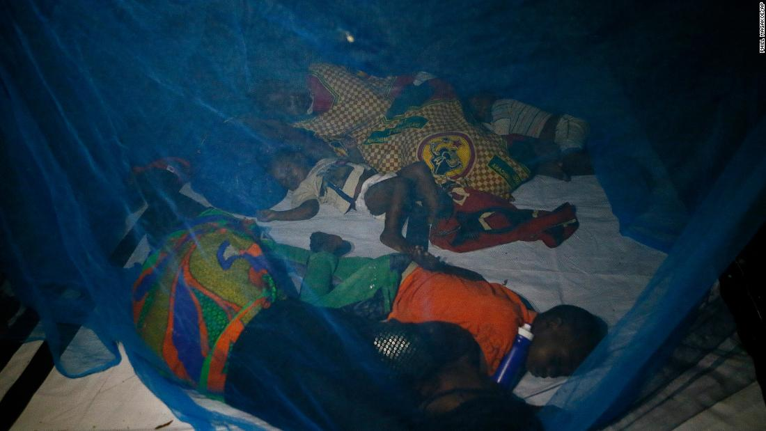 The displaced sleep under a mosquito net at a school housing survivors in Beira, Mozambique, on Sunday, March 24.