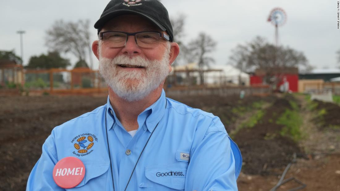 Mobile Loaves & Fishes founder Alan Graham stands in front of the organic farm in the heart of the Community First! Village.