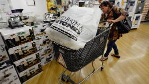 LOS ANGELES, CA - APRIL 10: Customers carry bags from Bed Bath & Beyond store on April 10, 2013 in Los Angeles, California. The home goods retailer is expected to release fourth-quarter earnings figures after the closing bell. (Photo by Kevork Djansezian/Getty Images)
