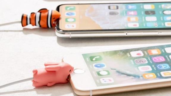 """<strong>An animal cable bite to protect your charging cables</strong> Cable Bite ($6; <a href=""""https://click.linksynergy.com/deeplink?id=Fr/49/7rhGg&mid=43176&u1=032250under15&murl=https%3A%2F%2Fwww.urbanoutfitters.com%2Fshop%2Fcable-bite"""" target=""""_blank"""" target=""""_blank"""">urbanoutfitters.com</a>)"""