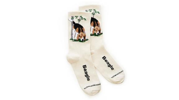 """<strong>A cozy pair of socks that feature your favorite doggo</strong> Choose Your Dog Breed Socks ($12; <a href=""""http://bit.ly/2YeOd46"""" target=""""_blank"""" target=""""_blank"""">uncommongoods.com</a>)"""