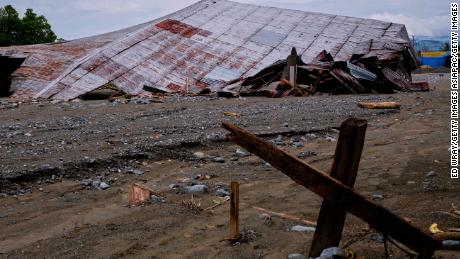 An airplane hanger brought down by flash floods sits in the mud in Sentani, Papua province, Indonesia.