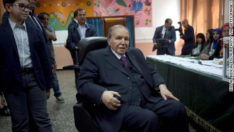 Army chief Ahmed Gaid Salah called for Algerian President Abdelaziz Bouteflika (center) to step down.