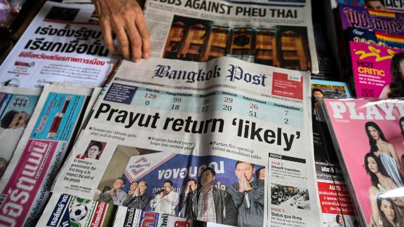Newspapers at a shop in Bangkok trumpet coverage of the general election.