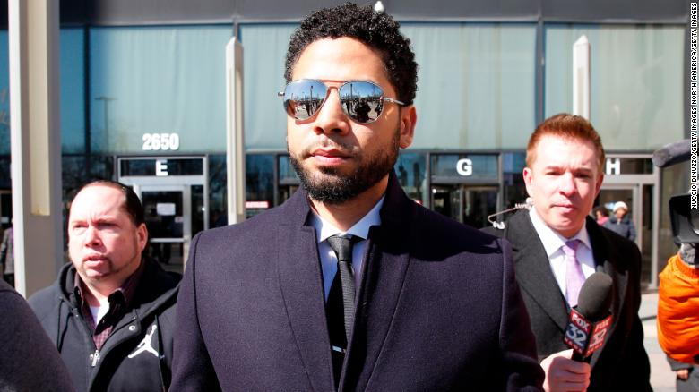 Jussie Smollett leaves a Chicago courthouse Tuesday after the charges were dropped against him.