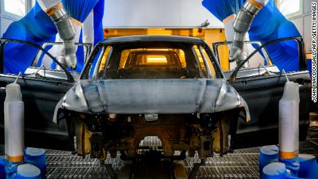 A Volkswagen car body is painted on a production line at German car manufacturing giant Volkswagen's headquarters in Wolfsburg, northern Germany, on March 1, 2019. - The Wolfsburg plant is currently producing Volkswagen Touran and Tiguan models, as well as Seat Tarraco models. (Photo by John MACDOUGALL / AFP)        (Photo credit should read JOHN MACDOUGALL/AFP/Getty Images)