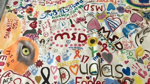 Students from Marjory Stoneman Douglas created a canvas mural at the library on the anniversary of the mass shooting.
