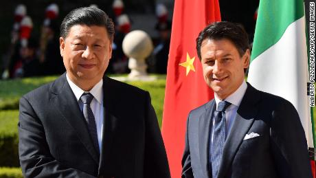 Italy's Prime Minister Giuseppe Conte (right) and Chinese President Xi Jinping shake hands on Xi Jinping's arrival for a meeting at Villa Madama on March 23, 2019 in Rome as part of the conference's two-day visit to Italy