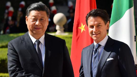 Italys Prime Minister Giuseppe Conte (right) and China's President Xi Jinping shake hands upon Xi Jinping's arrival for their meeting at Villa Madama in Rome on March 23, 2019 as part of a two-day visit to Italy.