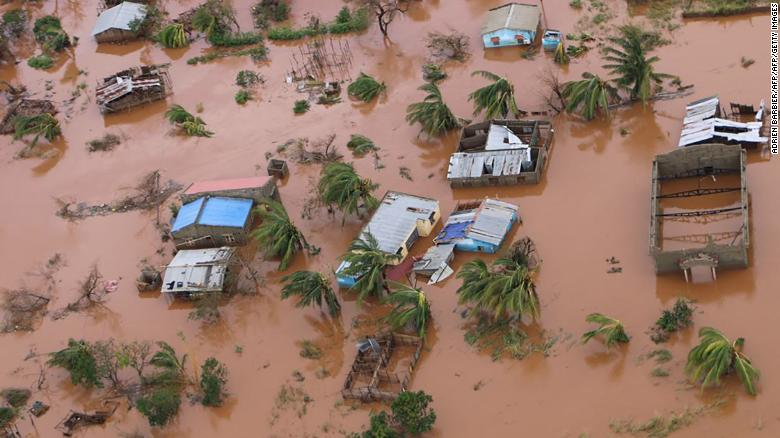 A picture shows houses in a flooded area of Buzi, central Mozambique, on March 20, 2019, after the passage of cyclone Idai.