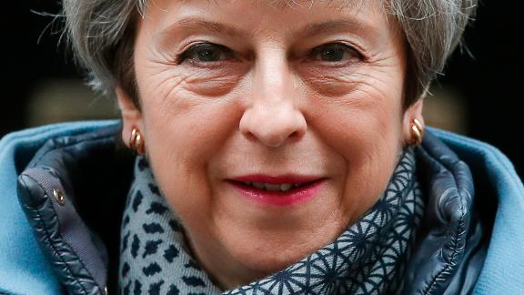 Britain's Prime Minister Theresa May leaves 10 Downing street to attend her weekly Prime Minster's Questions at the House of Commons, in London, Wednesday, March 27, 2019.  British lawmakers are preparing to vote Wednesday on alternatives for leaving the European Union as they seek to end an impasse following the overwhelming defeat of the deal negotiated by Prime Minister Theresa May. (AP Photo/Alastair Grant)