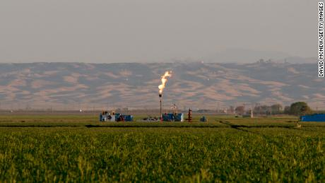 Gas is flared as waste at a California fracking facility in 2014.
