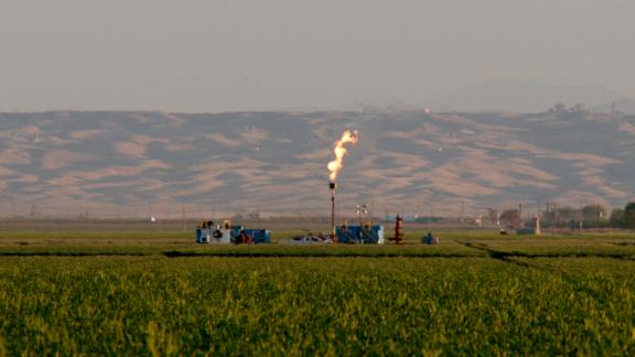 Natural gas flares shoot from a facility in California used for drilling.