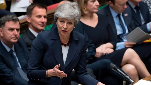 """Britain's Prime Minister Theresa May stands to talk to lawmakers inside the House of Commons parliament in London Wednesday March 27, 2019. As Lawmakers sought Wednesday for an alternative to May's unpopular Brexit deal with Europe, with a series of 'indicative votes"""", May offered to resign from office if her deal is passed by lawmakers at some point and Britain left the European Union. (Jessica Taylor/House of Commons via AP)"""