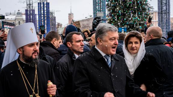 "KIEV, UKRAINE - JANUARY 07: Metropolitan Epiphanius of Kiev and All Ukraine (L), with Ukrainian President Petro Poroshenko (C) on Sofiyivska Square following Christmas liturgy at St. Sophia's Cathedral on January 07, 2019 in Kiev, Ukraine. The independent Orthodox Church of Ukraine, which previously fell under the authority of Moscow, was granted official recognition yesterday in a decree, or ""tomos,"" signed yesterday in Istanbul by the Ecumenical Patriarch of Constantinople Bartholomew I in a move with deep historical roots but fueled by contemporary political conflict between Ukraine and Russia. (Photo by Brendan Hoffman/Getty Images)"