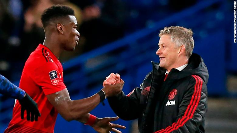Manchester United manager Ole Gunnar Solskjaer (right) with midfielder Paul Pogba.